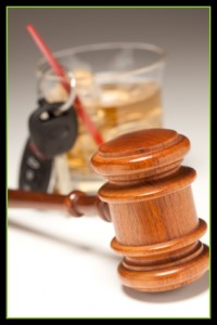 A gavel and a drink with keys symbolizing DUI charges that can be handled by the Law Offices of Jerod Gunsberg in Los Angeles, CA